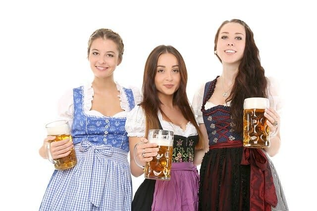 In munich's best parlours the beer is served by women in dirndl and men in lederhosen