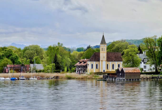 Ammersee, one of the most beautiful lakes around Munich; view at bank with church and houses