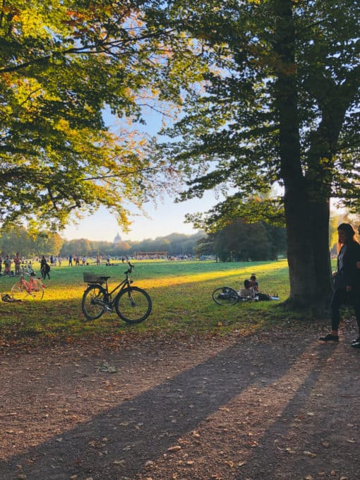 English Garden with bike and many people in the background